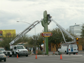 Bucket crane trucks installing the Gateway Saguaro